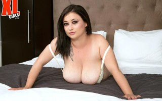 Chubby and busty girl Amie Taylor striping in bed