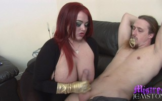 Mistress Jemstone smothers Merlin with boobies and tugs cock
