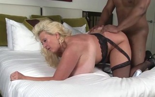 Huge fake tit blonde milf gets her ass pounded by big black cock and he shots his seed deep inside.