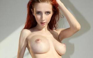 Helga Grey showing her big tits in her studio