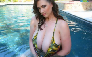 Lana Kendrick in a tye dye bikini gets wet