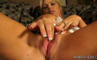 Amber Lynn Bach is dolled up in lingerie and masturbates.