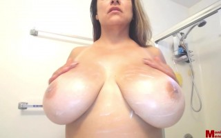 Monica Mendez lathers her boobs up with lotion after a day at the beach