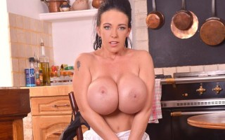 Huge fake boobs covered in milk