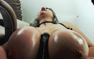 Samanta Lily titty-fucks a black dildo