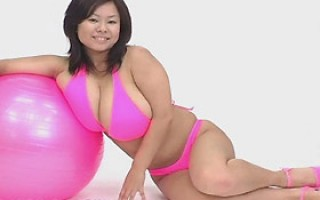 Japanese model with monster tits in pink bikini