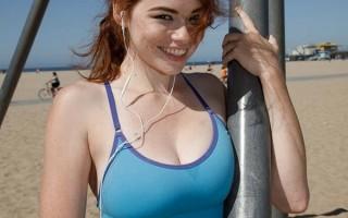 Big titty redhead Sabrina Lynn exercising in the beach
