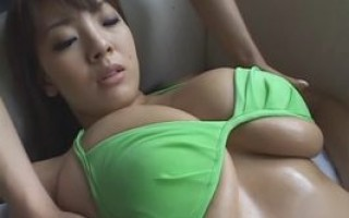 Busty asian in green bikini