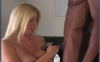 Blonde MILF sucks a big black cock hard then gets her big titties fucked.