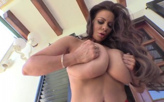 Linsey Dawn McKenzie Having Fun Giving Her Pinkish Nipples a Lick