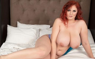 Chubby and busty redhead Alexsis Faye in bed