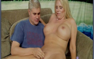 Hot blonde milf with big titties gets her shaved pussy fingered by blonde dude.