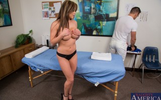 Busty brunette Mia Lelani is getting a massage and she gets fucked by the masseuse.