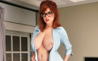Busty redhead Tessa Fowler in a blue button down shirt