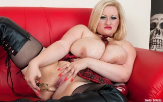 Sexy Teri Fox stripping off to show her boobs and dildo fuck