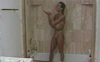 Tiffany Towers plays with her big perfect tits in the shower